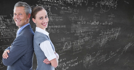 Digital composite of Business people back to back against grey wall with math doodles