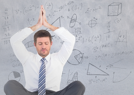 well dressed: Digital composite of Business man meditating against light grey wall with math doodles