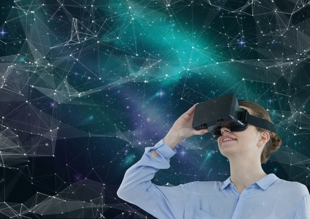 Digital composite of Woman in VR headset looking up against green and purple space background with interface