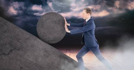 Digital composite of Man pushing 3D rolling round rock Stock Photo