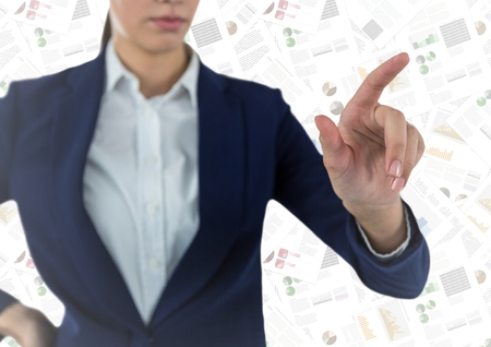 Digital composite of Business  woman mid section pointing against document backdrop Stock Photo