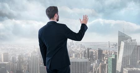 pretending: Digital composite of businessman in cityscape Stock Photo