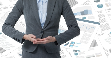 large group of business people: Digital composite of Business woman mid section with hands together against document backdrop Stock Photo
