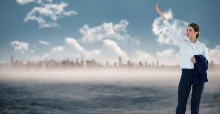 pretending: Digital composite of businesswoman in cityscape