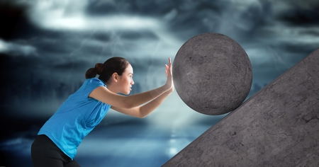 Digital composite of Woman pushing 3D rolling round rock