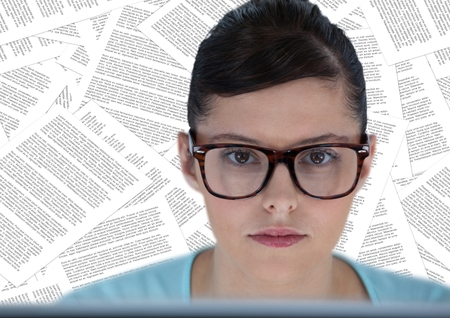 large group of business people: Digital composite of Close up of woman at computer against documents backdrop