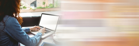 Digital composite of Back of woman typing on laptop with blurry orange transition Stockfoto