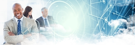 Digital composite of Business man arms folded with blue smart tech and clouds transition Stock Photo