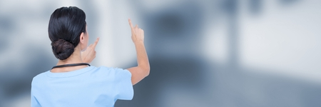 Digital composite of Doctor measuring with fingers against blue blurred hallway