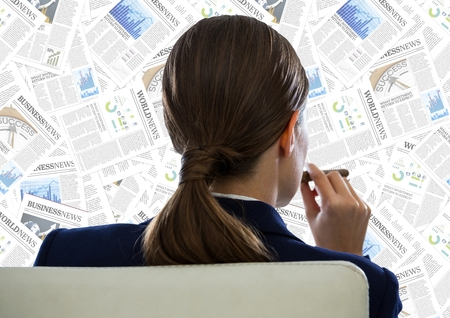 large group of business people: Digital composite of Back of business woman in chair looking at document backdrop