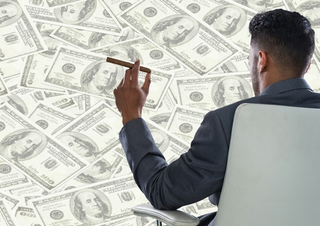 large group of business people: Digital composite of Back of business man in chair against money backdrop