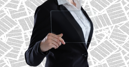 pretending: Digital composite of Business woman mid section with glass device against documents backdrop Stock Photo