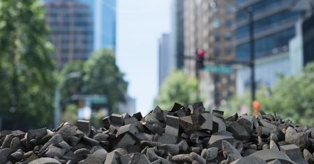 innumerable: Digital composite of Broken concrete rubble in cityscape