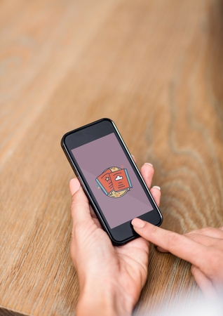 using smartphone: Digital composite of Person using a phone with education icon on the screen
