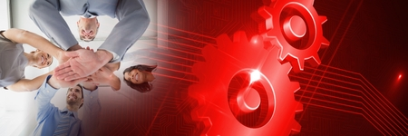 techology: Digital composite of Business team putting hands together with red cog transition