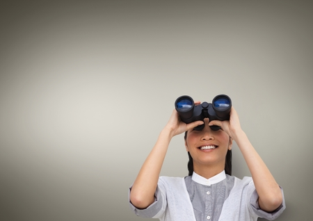 agitation: Digital composite of Happy woman looking through binoculars against brown background 3d