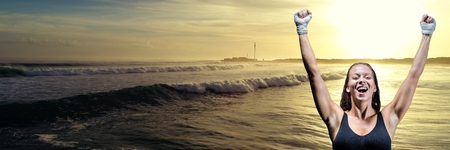 Digital composite of Athlete woman celebrating against waves and sunset 3d