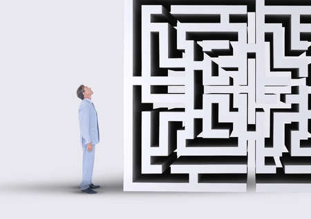man holding transparent: Digital composite of Man looking up to a maze 3d