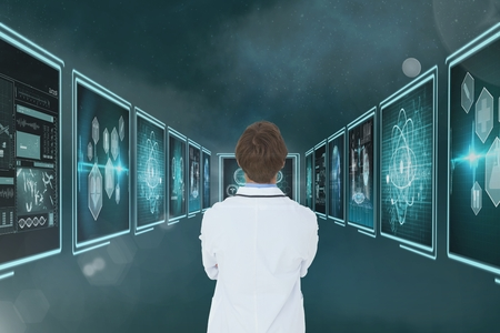 white coat: Digital composite of Man doctor looking at medical interfaces 3d