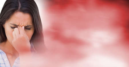wincing: Digital composite of Close up of frustrated woman and blurry red transition 3d Stock Photo