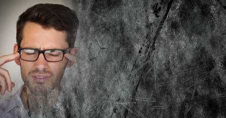 Digital composite of Portraiture of frustrated man with glasses and grey grunge transition and copy space