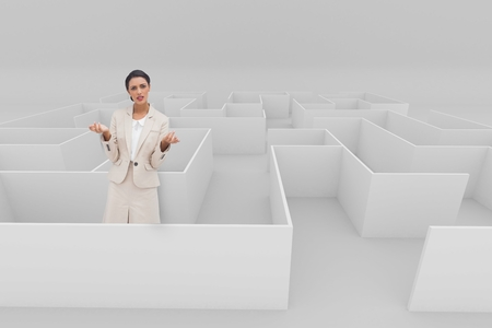Digital composite of Confused woman standing in a 3d maze