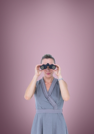 cut through: Digital composite of Woman looking through binoculars against pink background Stock Photo