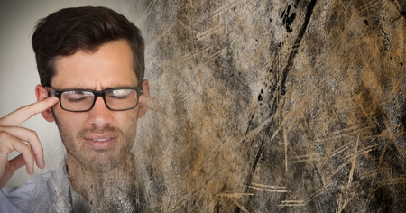 wincing: Digital composite of Portraiture of frustrated man with glasses and brown grunge transition