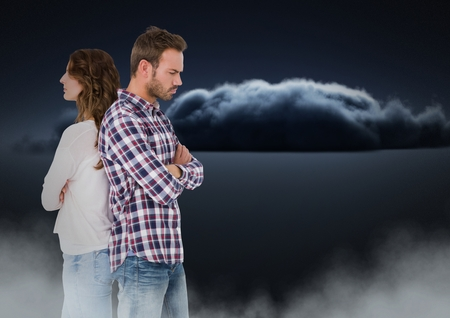 Digital composite of Couple facing back to back and upset with clouds