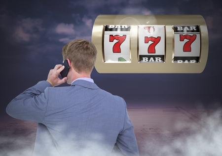 white coat: Digital composite of Back of Man Looking at 3d casino slot machine while on phone