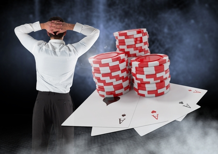 man looking out: Digital composite of Back of Man with casino 3d poker chips and playing cards