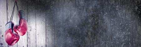 Digital composite of Boxing gloves with wood copy space transition Reklamní fotografie