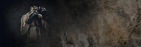 Digital composite of Boxer fighter man with dark grunge transition