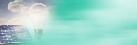 Digital composite of Light bulb with solar panels and blurry green copy space transition Stock Photo