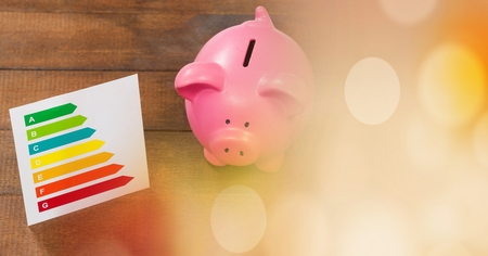 Digital composite of Piggy bank and chart with orange bokeh copy space transition