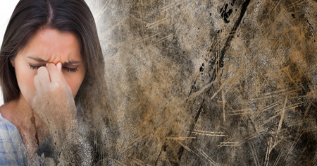 Digital composite of Close up of frustrated woman and brown grunge transition Stock Photo