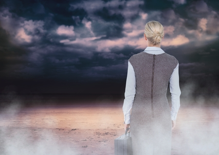 Digital composite of Back of Woman Looking at clouds