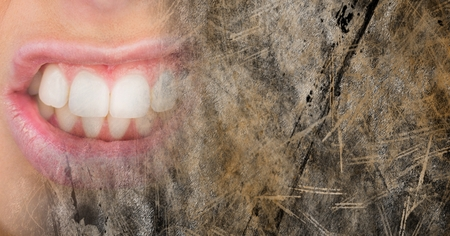 Digital composite of Close up of frustrated womans mouth and brown grunge transition