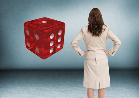 computer animation: Digital composite of Back of woman Looking at 3d dice Stock Photo