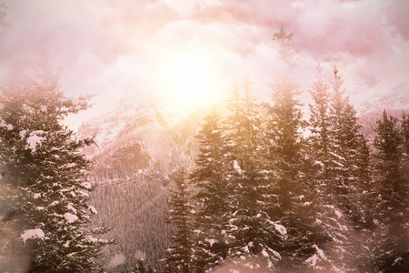 High angle view of cloudscape  against scenic view of snow covered mountains Stock Photo
