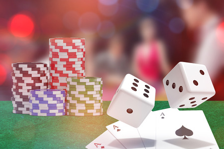 Computer generated 3D image of red dice against people sitting at table playing poker