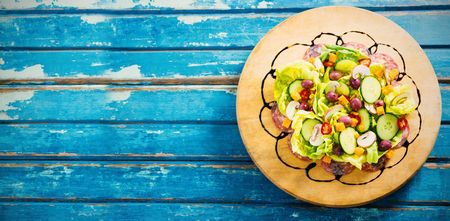 Overhead view of fresh food on blue wooden table Stock Photo