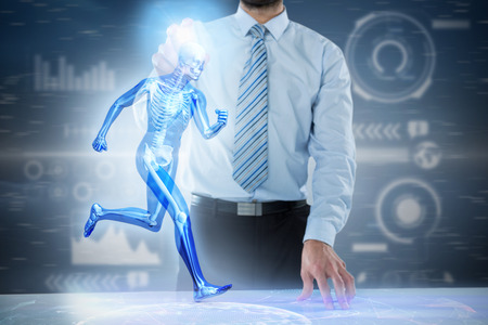 pretending: Midsection of businessman touching invisible 3D screen at desk against purple vignette Stock Photo