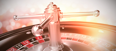 composite image: 3D image of roulette wheel against glowing background