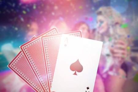 long night: Pretty girls holding champagne 3D glass against ace of spades with playing cards Stock Photo