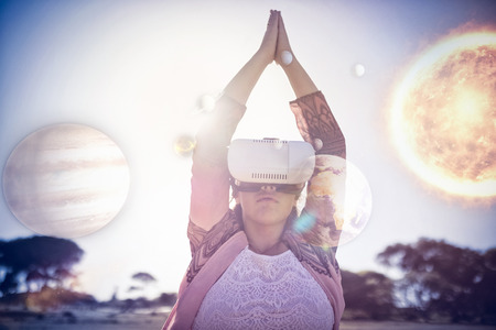 side viewing: Composite 3D image of solar system against white background against woman exercising while using virtual reality glasses against blue sky