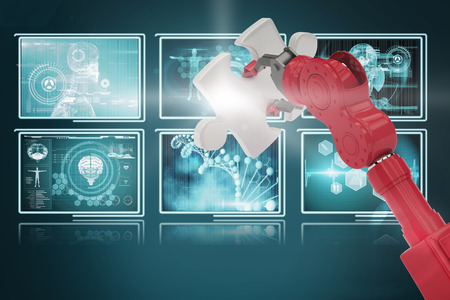 Cropped of 3D red robotic hand holding puzzle piece against screens with blue interface