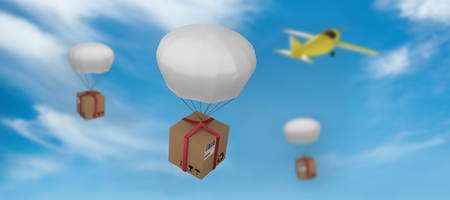 3D digital image of parachute carrying cardboard box against view of a blue sky Stock Photo
