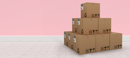 empty warehouse: Pile of packed cardboard 3D boxes against pink wall by hardwood floor Stock Photo