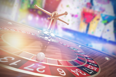 Midsection of bartender serving cocktail and martini against 3d image of ball on wooden roulette wheel Stock Photo